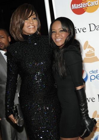 ** FILE ** In this Feb. 12, 2011, file photo, singer Whitney Houston, left, and her daughter Bobbi Kristina arrive at the Pre-Grammy Gala & Salute to Industry Icons with Clive Davis honoring David Geffen in Beverly Hills, Calif. (AP Photo/Dan Steinberg, file)