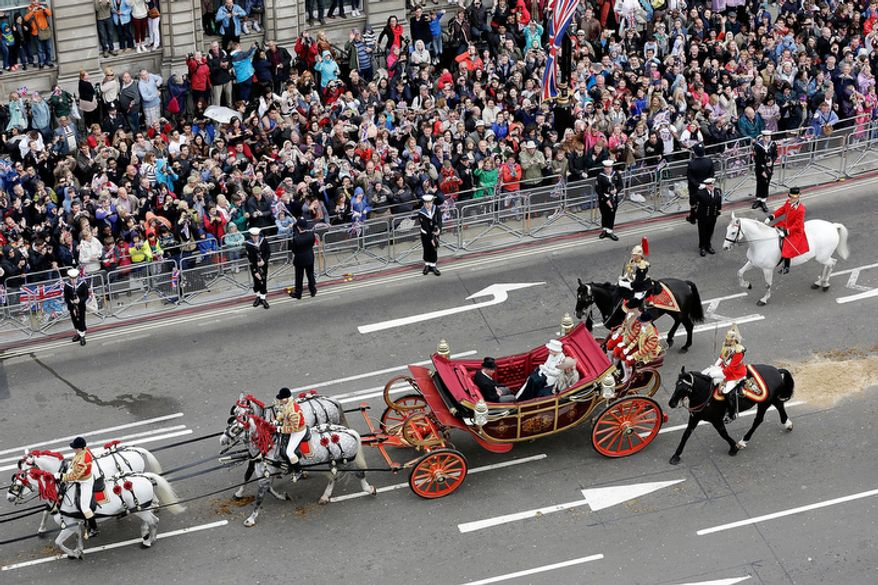 "Queen Elizabeth II, in carriage 2nd right, travels along Parliament Street to Buckingham Palace with Camilla, the Duchess of Cornwall and Prince Charles, after having lunch in Westminster Hall, London Tuesday June 5, 2012.  Pealing church bells and crowds cheering ""God save the queen!"" greeted Queen Elizabeth II on Tuesday as she arrived for a service at St. Paul's Cathedral on the last of four days of Diamond Jubilee celebrations honoring her 60 years on the throne. (AP Photo/Matthew Lloyd, Pool)"