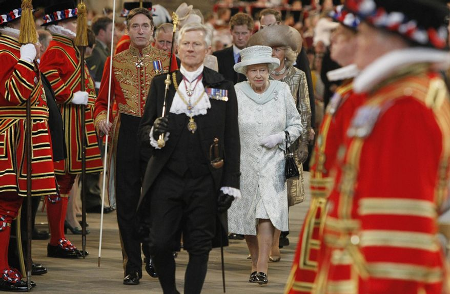 """Britain's Queen Elizabeth II leaves Westminster Hall in London after a Diamond Jubilee Luncheon. Crowds cheering """"God save the queen!"""" and pealing church bells greeted Queen Elizabeth II on Tuesday as she arrived for a service at St. Paul's Cathedral on the last of four days of celebrations of her 60 years on the throne. (AP Photo/Peter Byrne/Pool)"""