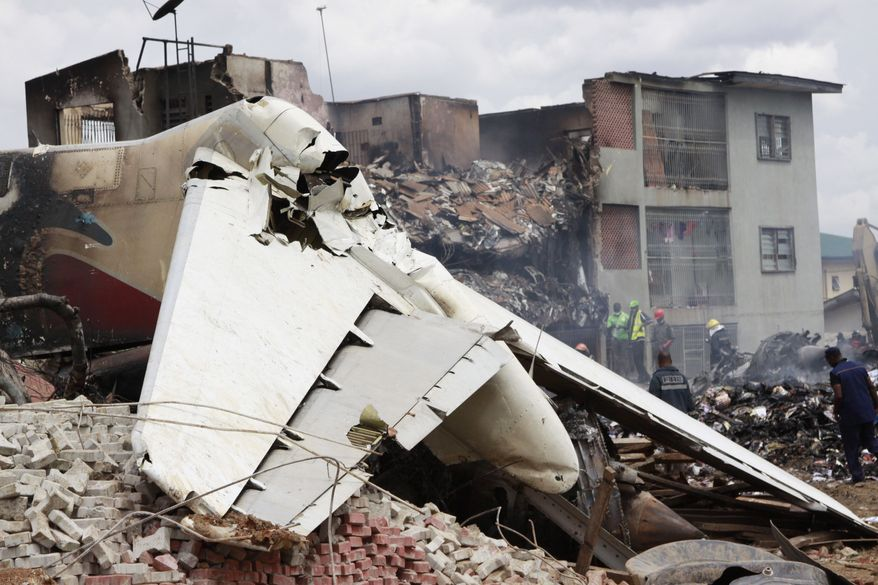 Debris from an MD-83 aircraft that crashed while approaching the airport in Lagos, Nigeria, on Sunday, June 3, 2012, is pictured on Monday. (AP Photo/Sunday Alamba)