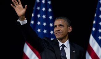 President Obama waves to the crowd during a campaign event at the New Amsterdam Theatre, Monday, June 4, 2012, in New York. (AP Photo/Carolyn Kaster)
