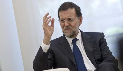 Spanish Prime Minister Mariano Rajoy gestures June 4, 2012, during a meeting with Republic of Singapore deputy premier Tharman Shanmugaratnam at La Moncloa palace in Madrid. (Associated Press)