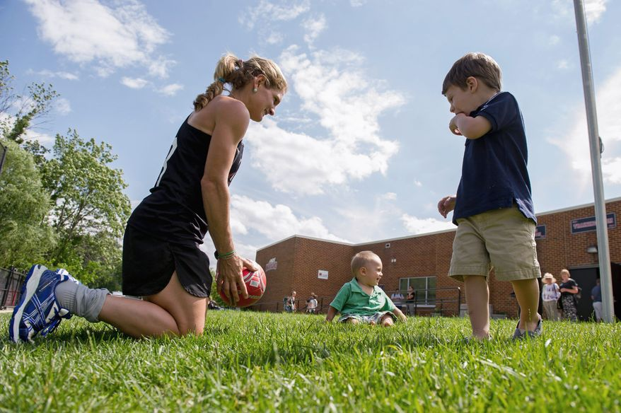 Keli Smith-Puzo of Selinsgrove, Pa., is kept busy with sons Ian, 9, and Xavi, 2, when she's not competing for a spot on the U.S. field hockey team. She scored three goals in the Beijing Games in 2008. (Andrew Harnik/The Washington Times)