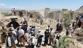 Villagers gather at a house destroyed in an apparent NATO raid in Logar province, south of Kabul, Afghanistan. Afghan officials and residents say a pre-dawn NATO airstrike aimed at militants in eastern Afghanistan killed civilians celebrating a wedding, including women and children. (Associated Press)