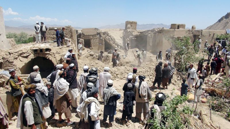 Villagers gather at a house destroyed in an apparent NATO raid in Logar province, south of Kabul, Afghanistan. Afghan officials and residents say a pre-dawn NATO airstrike aimed at militants in eastern Afghanistan killed civilians celebrating a