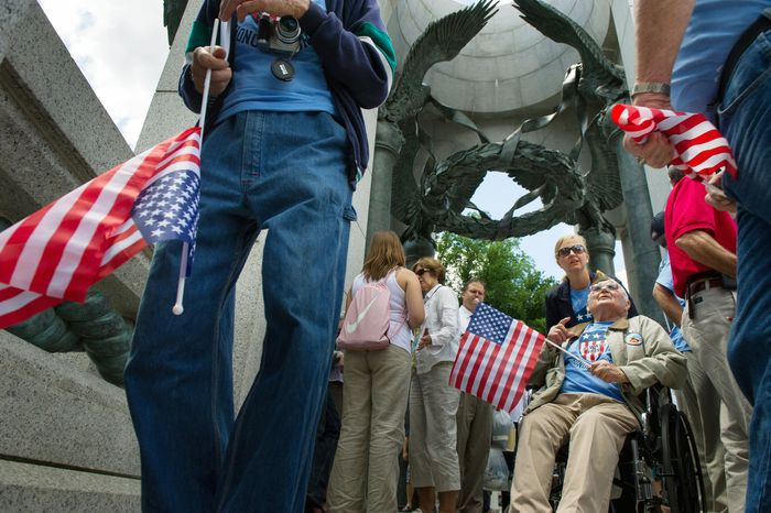 World War II veteran Andy Semonco, 88, of Elkhorn, W.Va., (right), who fought in the Battle of the Bulge, visited the National World War II Memorial on Wednesday on the 68th anniversary of D-Day. (Andrew Harnik/The Washington Times)