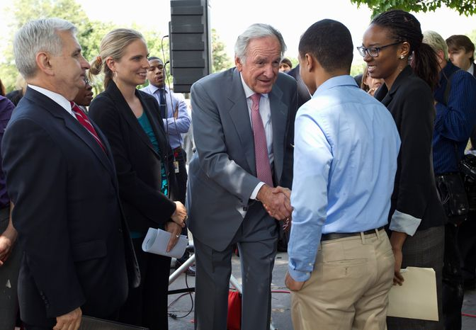 Sen. Jack Reed (left), Rhode Island Democrat, and Sen. Tom Harkin (center), Iowa Democrat, meet on Capitol Hill on Wednesday with college interns as they call for action on averting a July 1 doubling of interest rates on federal college