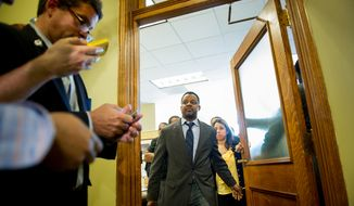 D.C. Council Chairman Kwame Brown leaves his office at the Wilson Building. (Andrew Harnik/The Washington Times)