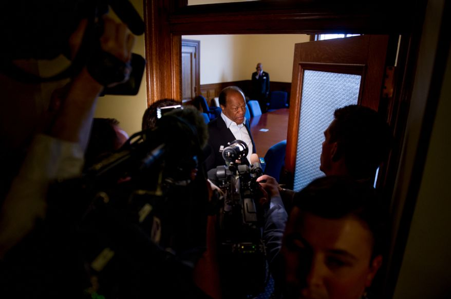 D.C. Councilmember Marion Barry (D-Ward 8), center, speaks to the media before having a closed door discussion with the council at the Wilson Building. (Andrew Harnik/The Washington Times)