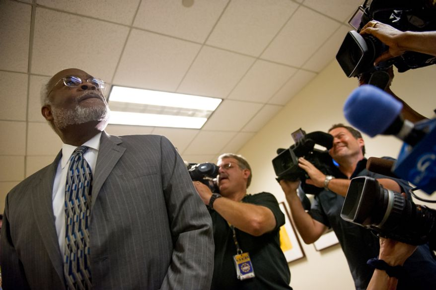 Attorney Fred Cooke walks into D.C. Council Chairman Kwame Brown's offices as he is charged with one felony count of bank fraud, Washington, D.C., Wednesday, June 6, 2012.  (Andrew Harnik/The Washington Times)