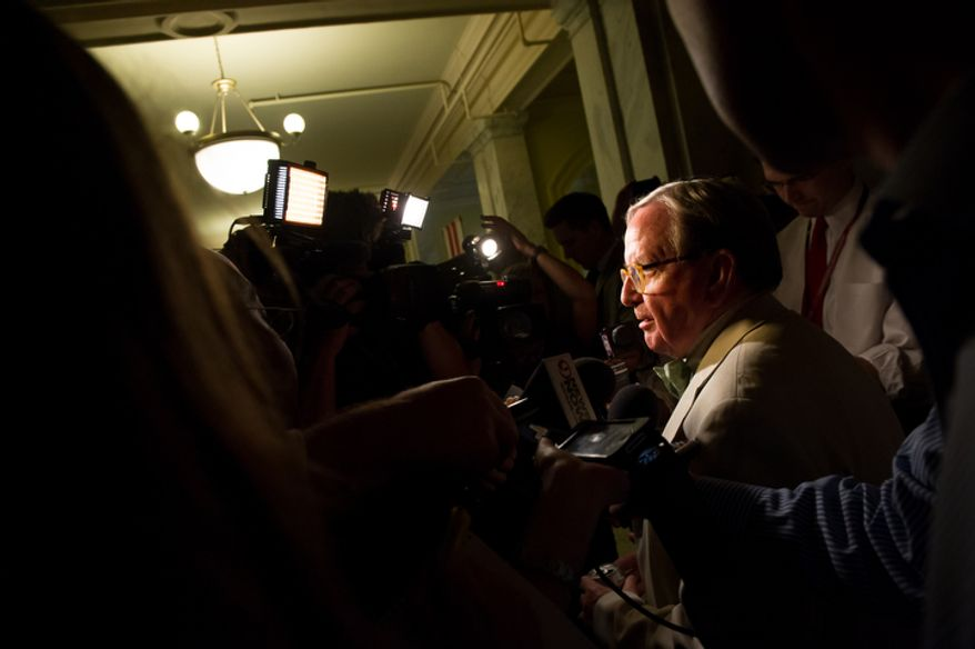 D.C. Councilmember Jim Graham (D-Ward 1) speaks to the media before having a closed door discussion with the council. (Andrew Harnik/The Washington Times)