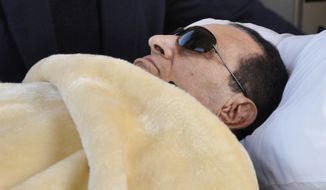 **FILE** Former Egyptian President Hosni Mubarak is wheeled into court in Cairo on Jan. 29, 2012. (Associated Press)