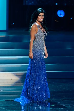 In this photo provided by the Miss Universe Organization, Miss Pennsylvania Sheena Monnin competes during the 2012 Miss USA Presentation Show on Wednesday, May 30, 2012 in Las Vegas. Monnin resigned her crown claiming the contest is rigged, but according to organizers the beauty queen