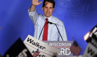 Wisconsin Gov. Scott Walker waves during his victory party on Tuesday, June 5, 2012, in Waukesha, Wis., after defeating Democratic challenger Tom Barrett in a special recall election. (AP Photo/Morry Gash)