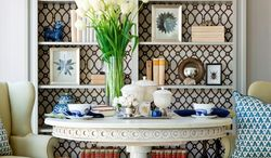Photo by Angie Seckinger Marika Meyer of Marika Meyer Interiors in the District, suggests using fabric or wallpaper in the back of a bookcase to add interest.