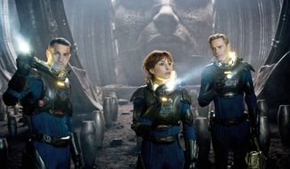 "Logan Marshall-Green (left) and Noomi Rapace are scientists tracking humanity's origins, a search that takes them to another galaxy, and Michael Fassbender (right) is an android in ""Prometheus."" (20th Century Fox via Associated Press)"