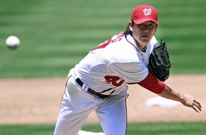 Nationals right-hander Chien-Ming Wang threw 84 pitches in 5  1/3 innings Washington's 3-1 loss to the New York Mets at Nationals Park. (A