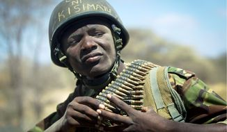 "The helmet of Kenyan soldier Nicholas Munyanya reads in Kiswahili ""Tea in Kismayo,"" no doubt hoping for respite in the strategic Somali port city that African Union troops hope to wrest from the control of al-Shabab terrorists by late August. (Associated Press)"