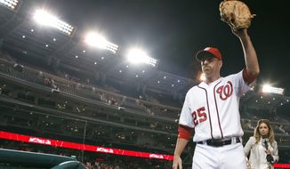 Washington Nationals first baseman Adam LaRoche acknowledges the fans after his four RBI led the team to a 5-3 victory over the New York Mets on Wednesday, June 6, 2012, in Washington. (AP Photo/Alex Brandon)