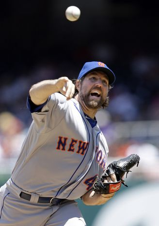 New York Mets pitcher R.A. Dickey is the first to reach nine wins this season. The knuckleballer tossed 7 1/3 scoreless innings against the Washington Nationals in the Mets' 3-1 win Thursday. (AP Photo/Jacquelyn Martin)
