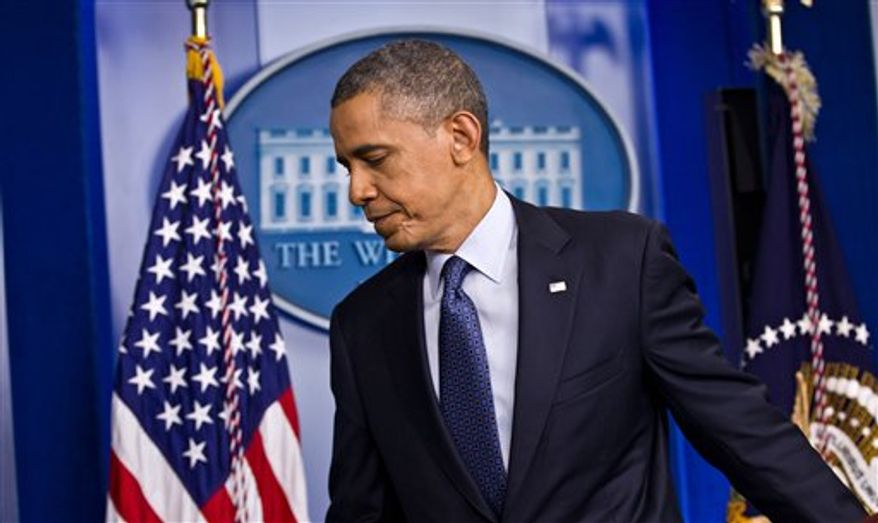 President Obama leaves after talking about the economy on Friday, June 8, 2012, in the briefing room of the White House in Washington. (AP Photo/J. Scott Applewhite)