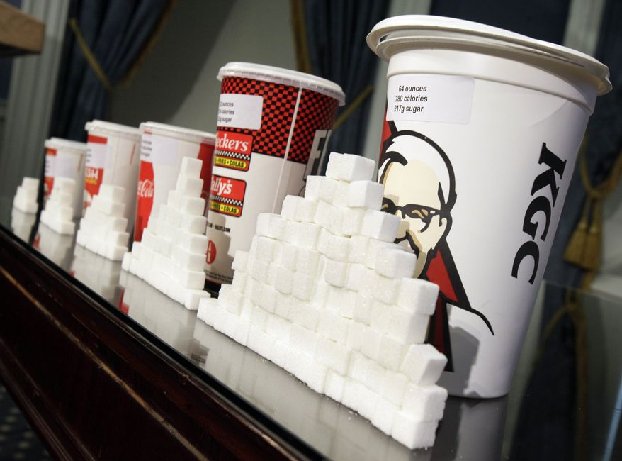 **FILE** Various size cups and sugar cubes are displayed May 31, 2012, at a news conference at New York's City Hall. (Associated Press)