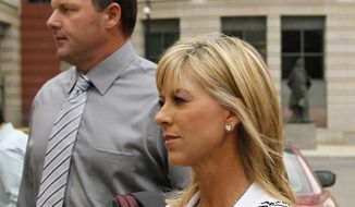 FILE - In this July 6, 2011 file photo, former Major League Baseball pitcher Roger Clemens, left, with his wife Debbie Clemens arrive at federal court in Washington. Debbie Clemens testified Friday that her husband was not present when she received a shot of human growth hormone from Roger Clemens' strength coach - testimony that contradicts the star pitcher's chief accuser in the perjury trial. (AP Photo/Alex Brandon, File)