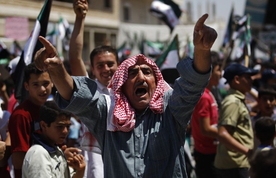 A Syrian chants slogans during a protest against Syrian President Bashar Assad after prayers on the outskirts of Idlib, Syria, on Friday, June 8, 2012. (AP Photo)