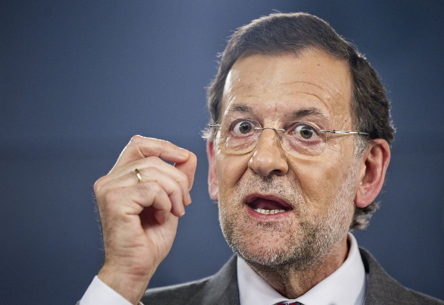 Spanish Prime Minister Mariano Rajoy speaks during a press conference after a meeting with Dutch Prime Minister Mark Rutte at the Moncloa Palace in Madrid on Thursday, June 7, 2012. (AP Photo/Daniel Ochoa de Olza)