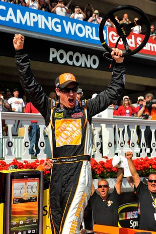 Pole-sitter Joey Logano overtook Mark Martin with three laps left to capture the Pocono 400, the second Sprint Cup win of the season for the Joe Gibbs Racing driver. (Associated Press)