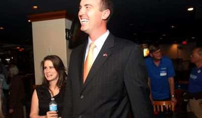 Jesse Kelly, the Republican candidate in southern Arizona's 8th Congressional District, seen here in April with wife Aubrey Kelly in Tucson, Ariz., is seeking the seat he narrowly lost in November 2010 in a special election on Tuesday. (Associated Press)