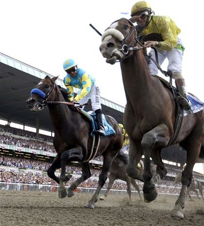 Union Rags (inside) passed Paynter just before the wire to deny owner Ahmed Zayat, trainer Bob Baffert and jockey Mike Smith their first Triple Crown win of the season after back-to-back second-place finishes. (Associated Press)