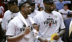 Miami Heat's LeBron James stands with Dwyane Wade during the trophy presentation following the Heat's 101-88 victory over the Boston Celtics in Game 7 of the Eastern Conference finals Saturday, June 9, 2012, in Miami. (AP Photo/Lynne Sladky)