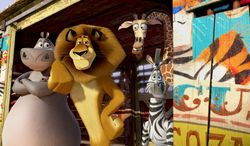 """This film image released by DreamWorks Animation shows, Gloria the Hippo, voiced by Jada Pinkett Smith, from left, Alex the Lion, voiced by Ben Stiller, Melman the Giraffe, voiced by David Schwimmer, and Marty the Zebra, voiced by Chris Rock in a scene from """"Madagascar 3: Europe's Most Wanted."""" (AP Photo/DreamWorks Animation - Paramount Pictures)"""