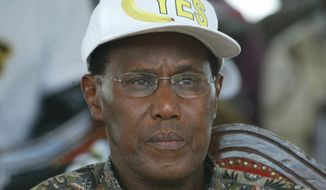 ** FILE ** Kenyan Internal Security Minister George Saitoti is seen during a state function in Nairobi, Kenya, in November 2005. (AP Photo/Sayyid Azim)