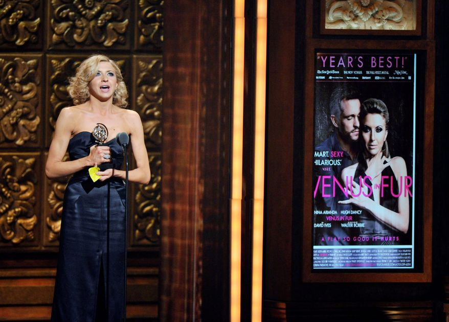 "Nina Arianda, 27, accepts the Tony for leading actress in a play for ""Venus in Fur"" at Sunday's Tony Awards in New York. She is one of five first-time winners, all younger than 40, hailed as Broadway's next class. (Invision via Associated Press)"