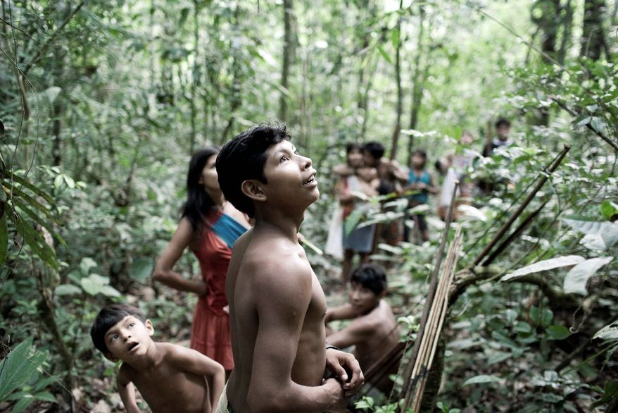 For generations, the Awa lived far away from the rest of humanity, following the seasons' rhythms in the lush Brazilian Amazon rainforest. Watchdog groups say conflict is inevitable as government-backed projects such as hydroelectric dams and roads bring thousands of settlers to remote areas, weakening tribes' hold on their lands. (Associated Press)