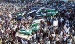 This citizen journalism image taken on Saturday purports to show anti-Syrian regime mourners carrying the coffins of Syrian citizens killed in shelling by Syrian troops in Daraa, Syria. According to the Britain-based Syrian Observatory for Human Rights, civilians were killed in heavy shelling on Saturday in Daraa, where the uprising began in March 2011. (Associated Press)