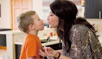 "Bristol Palin shares an affectionate moment with her son, Tripp, during filming of her 10-episode Lifetime series, ""Bristol Palin: Life's a Tripp."" She talks about how single motherhood has forced her to mature, but many of the scenes cast doubt on that message. (Associated Press)"