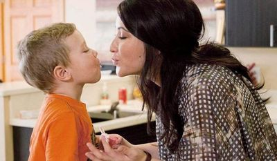 """Bristol Palin shares an affectionate moment with her son, Tripp, during filming of her 10-episode Lifetime series, """"Bristol Palin: Life's a Tripp."""" She talks about how single motherhood has forced her to mature, but many of the scenes cast doubt on that message. (Associated Press)"""