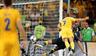 Team captain Andriy Shevchenko (7) heads in one of his two goals in Ukraine's 2-1 win over Sweden in a Euro 2012 Group D match in Kiev, Ukraine.