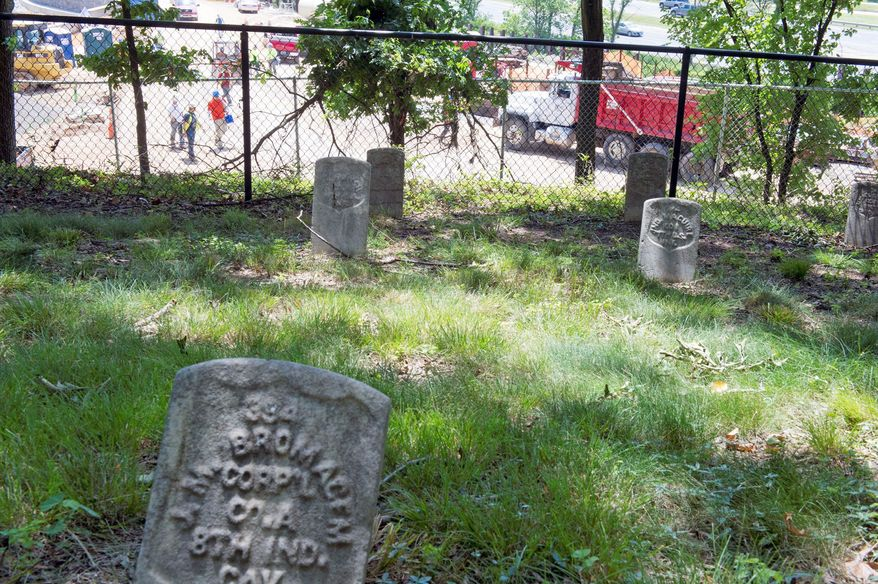 This Civil War graveyard on the grounds of the West Campus of the former St. Elizabeths Hospital overlooks the construction site of what will become the new Coast Guard headquarters. This entire campus is being rebuilt to house the Department of Homeland Security. The cemetery with its 300 graves will remain. (Barbara L. Salisbury/The Washington Times)