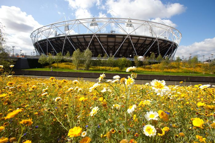 The British government and Olympics organizers hope investment in long-neglected parts of East London, where Olympic Park and the shiny new stadium are located, will have a lasting impact. However, behind the regeneration hyperbole of the organizers and politicians, the reality is very different, a shop owner says. (Associated Press)