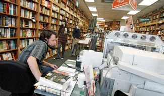 Bill Leggett works on the Espresso Book Machine, known as Opus, at Politics and Prose bookstore in Washington, D.C., earlier this month. Self-publishing has been made easier since the machine by On Demand Books debuted in 2006. (Associated Press)