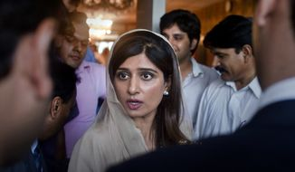**FILE** Pakistani Foreign Minister Hina Rabbani Khar talks May 14, 2012 to reporters after a press conference in Islamabad, Pakistan. (Associated Press)