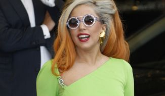 Lady Gaga arrives at the Sungshan Airport in Taipei, Taiwan, on Wednesday, May 16, 2012, while on a world tour. (AP Photo/Wally Santana)
