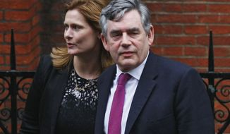 Former Prime Minister Gordon Brown arrives June 11, 2012, at the High Court in London with his wife, Sarah, to give evidence at Britain's inquiry into media ethics. (Associated Press)