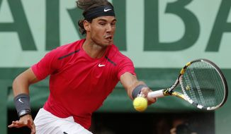 Spain's Rafael Nadal returns the ball to Serbia's Novak Djokovic during their men's final match in the French Open tennis tournament at the Roland Garros Stadium in Paris on Monday, June 11, 2012. (AP Photo/Michel Euler)