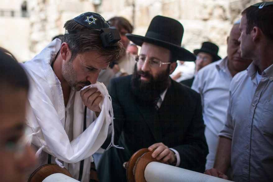 Actor David Arquette (left) celebrates his bar mitzvah at the Western Wall, the holiest site where Jews can pray, in Jerusalem's Old City on Monday, June 11, 2012. (AP Photo/Israeli Tourism Ministry)