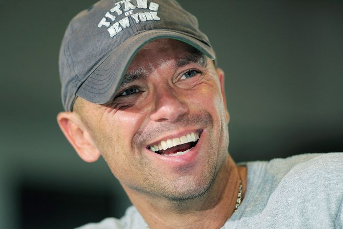"""Kenny Chesney will collaberate with Oscar-winning director Jonathan Demme on the """"American Express Unstaged"""" music series June 20. (Associated Press)"""